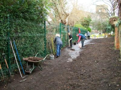 Brushing down the path on the first volunteer day